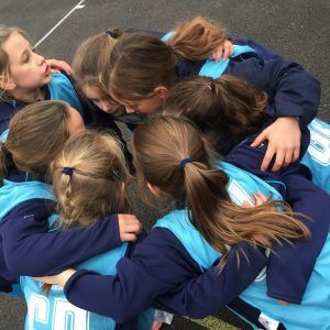 19 Girls Sporting Highlights Netball team huddle who's our player of the match